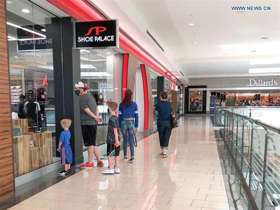 Shopping mall reopens with shortened business hours in Dallas